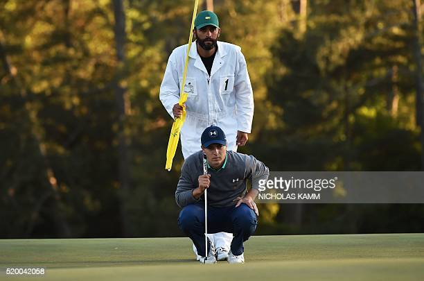 US golfer Jordan Spieth lines up putt on the 18th green during Round 3 of the 80th Masters Golf Tournament at the Augusta National Golf Club on April...