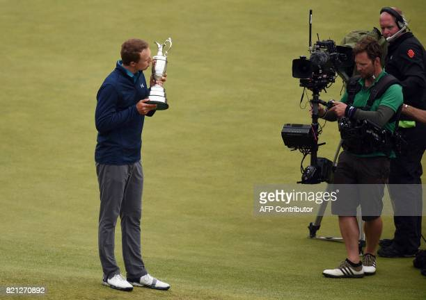 US golfer Jordan Spieth poses for pictures as he kisses the Claret Jug the trophy for the Champion golfer of the year after winning the 2017 British...