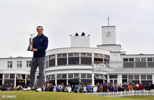 US golfer Jordan Spieth poses for pictures with the Claret Jug the trophy for the Champion golfer of the year in front of the ArtDecostyle clubhouse...