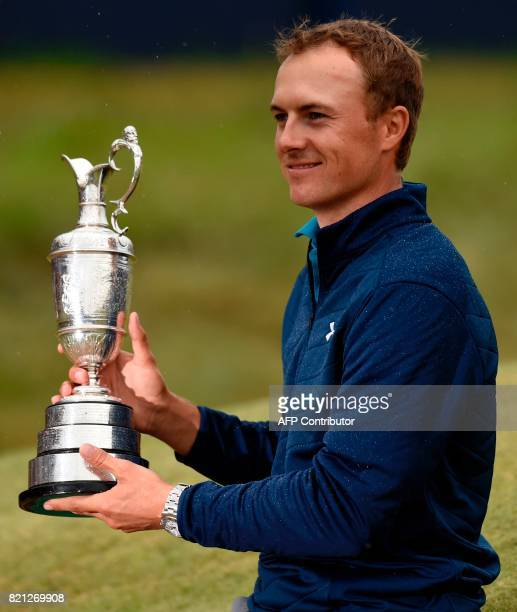 US golfer Jordan Spieth poses for pictures with the Claret Jug the trophy for the Champion golfer of the year after winning the 2017 British Open...