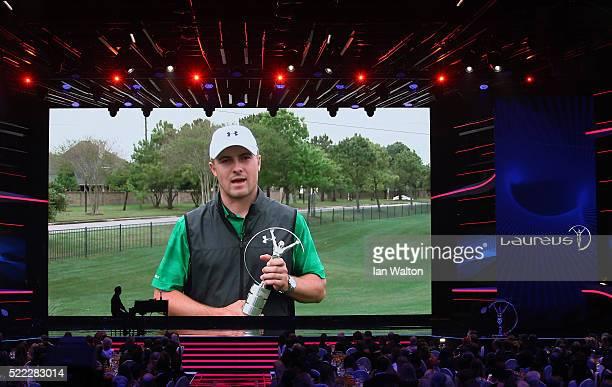 Golfer Jordan Spieth poses with his Laureus World Breakthrough of the Year Award trophy via video during the 2016 Laureus World Sports Awards at the...