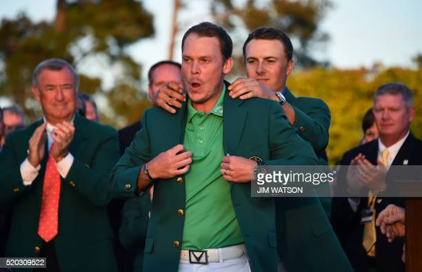 TOPSHOT US golfer Jordan Spieth presents the Green Jacket to England's Danny Willett at the end of the 80th Masters Golf Tournament at the Augusta...
