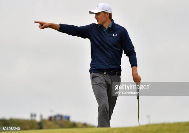 US golfer Jordan Spieth reacts after making his putt on the 15th green for eagle during his final round 69 on day four of the 2017 Open Golf...