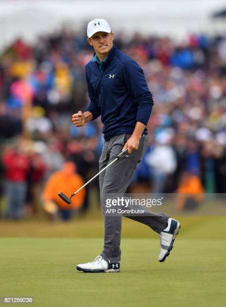 US golfer Jordan Spieth reacts after making his putt on the 16th green for birdie during his final round 69 on day four of the 2017 Open Golf...