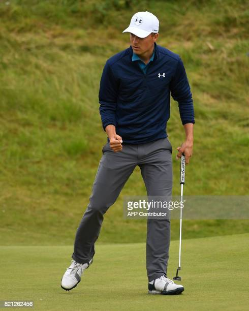 US golfer Jordan Spieth reacts after making his putt on the 17th green for birdie during his final round 69 on day four of the 2017 Open Golf...