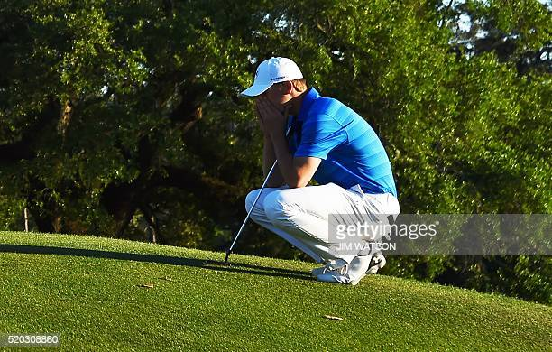 US golfer Jordan Spieth reacts on the 18th green during Round 4 of the 80th Masters Golf Tournament at the Augusta National Golf Club on April 10 in...