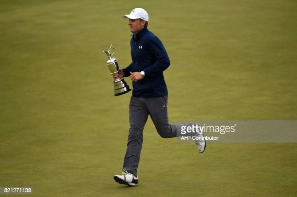 US golfer Jordan Spieth runs to share the Claret Jug with spectators the trophy for the Champion golfer of the year after winning the 2017 British...