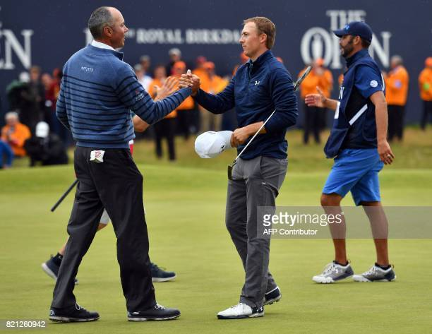 US golfer Jordan Spieth shakes hands with US golfer Matt Kuchar on the 18th green after their final rounds on day four of the 2017 Open Golf...