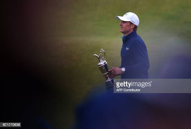 US golfer Jordan Spieth shows off the Claret Jug the trophy for the Champion golfer of the year after winning the 2017 British Open Golf Championship...