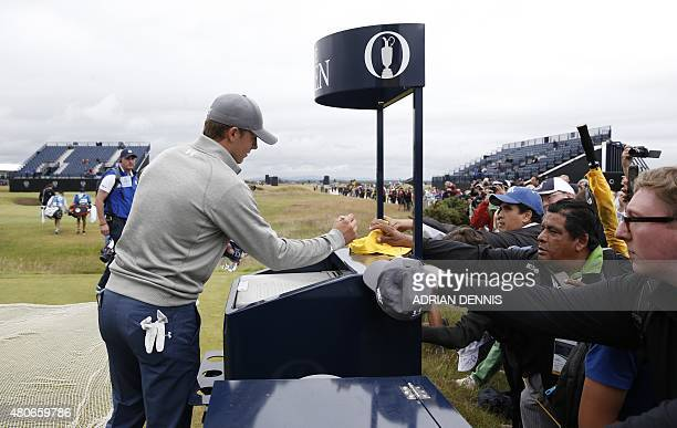 US golfer Jordan Spieth signs autographs on the 3rd tee during a practice round on The Old Course at St Andrews in Scotland on July 14 ahead of The...