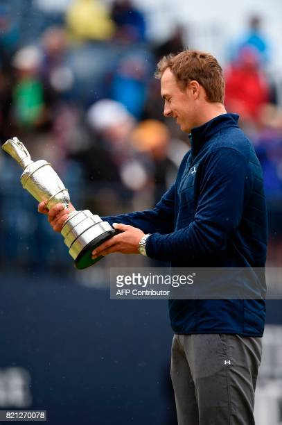US golfer Jordan Spieth studies names on the Claret Jug the trophy for the Champion golfer of the year after winning the 2017 British Open Golf...