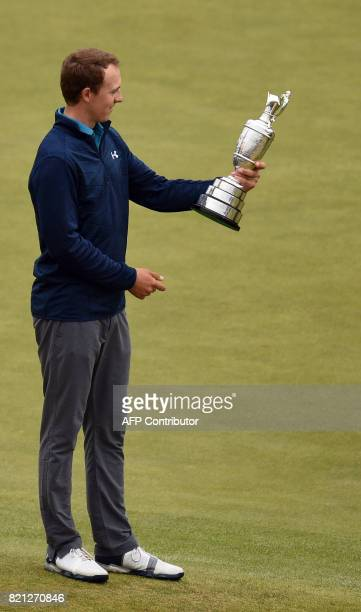 US golfer Jordan Spieth studies the names on the Claret Jug the trophy for the Champion golfer of the year after winning the 2017 British Open Golf...