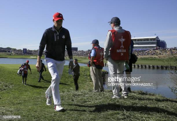 Golfer Jordan Spieth walks during his singles match with Europe's Danish golfer Thorbjorn Olesen on the third day of the 42nd Ryder Cup at Le Golf...