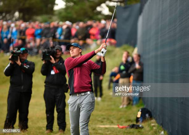 US golfer Jordan Spieth watches his shot from the rough on the 5th hole during his second round on day two of the Open Golf Championship at Royal...