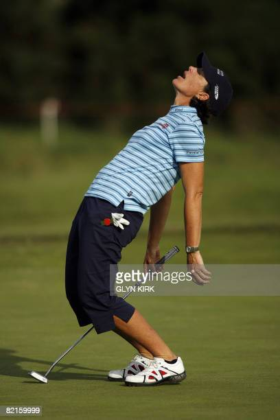 US golfer Juli Inkster misses a putt on the 17th green during the third round of the Women's British Open Championship at Sunningdale golf course on...