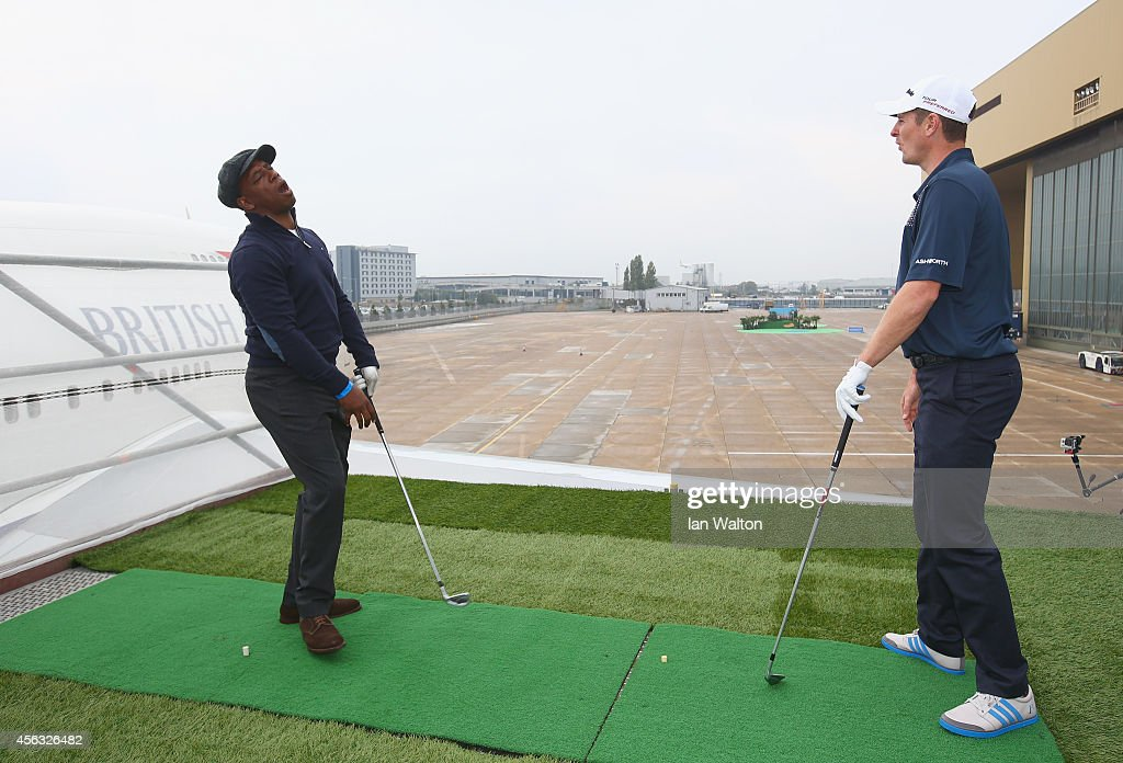 Golfer Justin Rose and Ian Wright plays a shot from the wing of a British Airways Boeing 747 to a target 180 yards away during an event to raise funds for the Kate and Justin Rose Foundation at Heathrow Airport on September 29, 2014 in London, England. British Airways has donated flights to the Kate and Justin Rose foundation, which was created to inspire children through nutrition, education and experiences