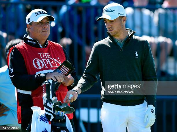 US golfer Justin Thomas and his caddie Jimmy Johnson wait on the 14th tee during his first round 67 on the opening day of the 2016 British Open Golf...