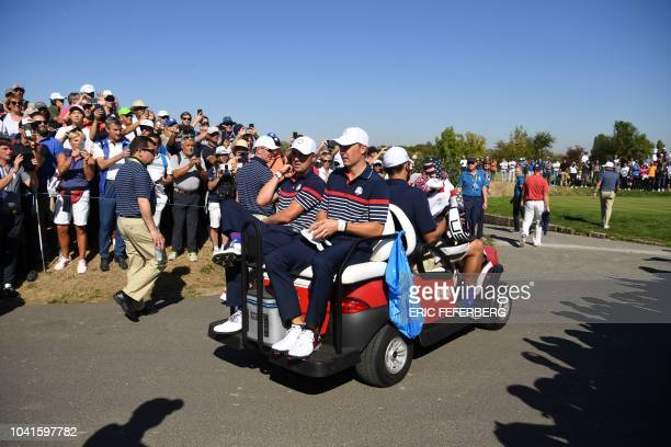 US golfer Justin Thomas and US golfer Jordan Spieth travel on a golf cart during a practice session ahead of the 42nd Ryder Cup at Le Golf National...