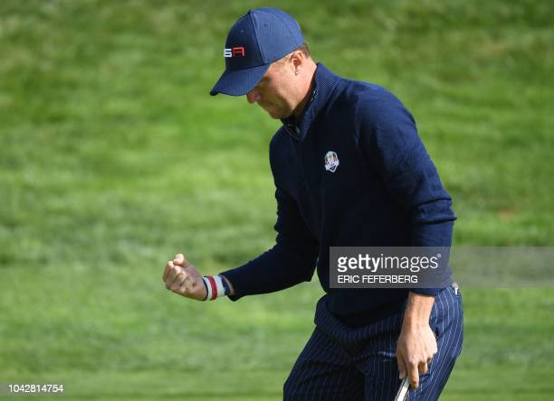 US golfer Justin Thomas celebrates after winning his fourball match on the second day of the 42nd Ryder Cup at Le Golf National Course at...