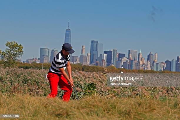 USA golfer Justin Thomas chips on the 10th hole during the final round of the Presidents Cup at Liberty National Golf Club on September 30 2017 in...