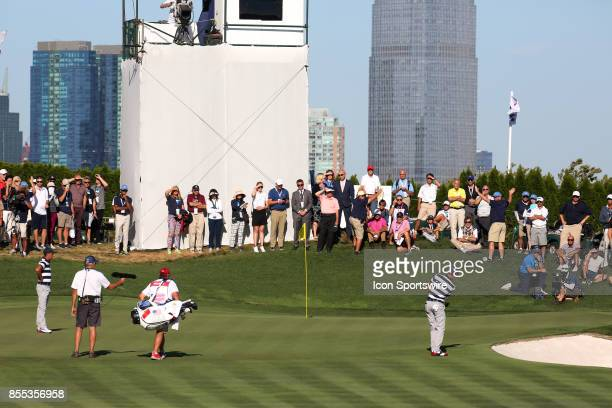 USA golfer Justin Thomas chips on the 14th hole during the first round of the Presidents Cup on September 28 at Liberty National Golf Club in Jersey...