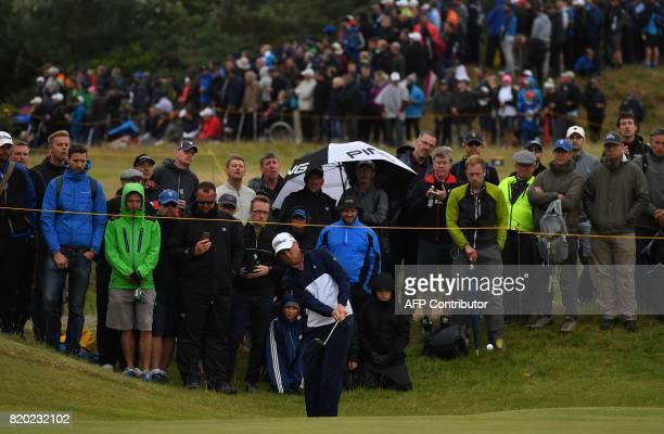 US golfer Justin Thomas chips onto the 3rd green during his second round on day two of the Open Golf Championship at Royal Birkdale golf course near...