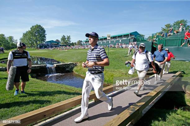 PGA golfer Justin Thomas crosses a bridge as he walks to the 15th tee during the Memorial Tournament Second Round at Muirfield Village Golf Club in...