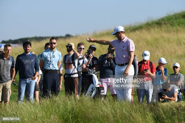 Golfer Justin Thomas drops a ball as he competes in the HNA Open de France, as part of the European Tour 2018, at the Saint-Quentin-en-Yvelines...
