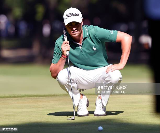 US golfer Justin Thomas eyes the ball at green 16 during the fourth and last round of the World Golf Championship in Mexico City on March 4 2018...
