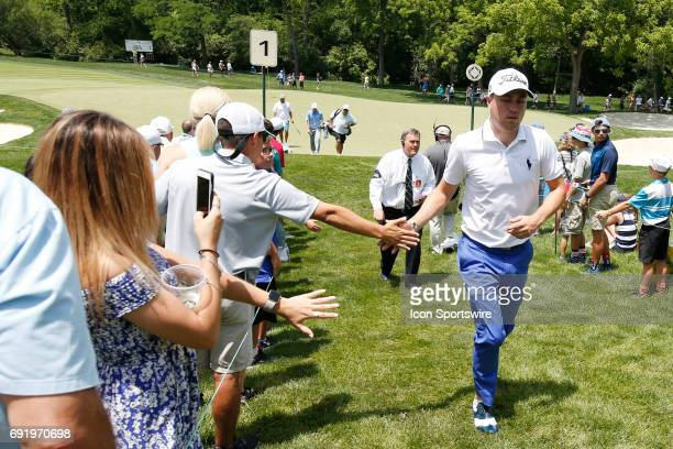 PGA golfer Justin Thomas high fives fans as he walks to the 2nd tee during the Memorial Tournament Third Round on June 03 2017 at Muirfield Village...