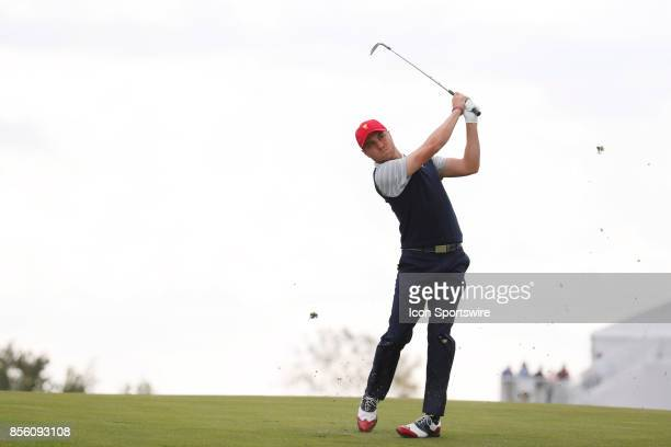USA golfer Justin Thomas hits his second shot on the 17th hole during the third round of the Presidents Cup at Liberty National Golf Club on...