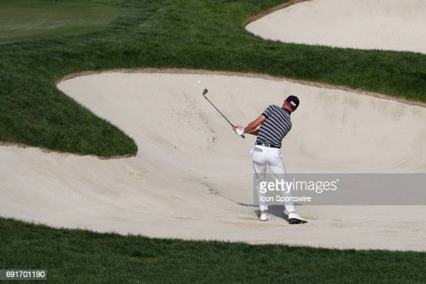 Golfer Justin Thomas hits out of a sand trap on the 17th hole during the Memorial Tournament - Second Round on June 02, 2017 at Muirfield Village...
