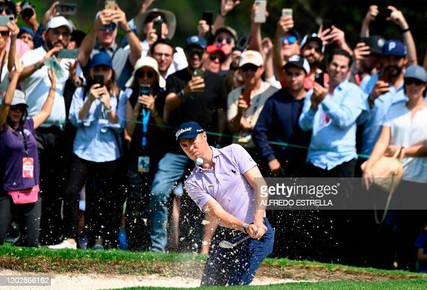 Golfer Justin Thomas hits out of the rough on the 1st hole fairway, during the fourth and last round of the World Golf Championship, at Chapultepec's...