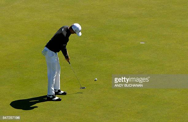 US golfer Justin Thomas holes this putt on the 15th Green during his first round 67 on the opening day of the 2016 British Open Golf Championship at...