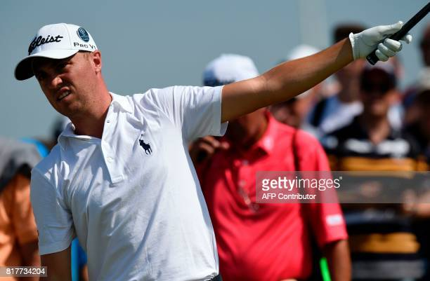 US golfer Justin Thomas indicates a wayward drive on the 15th tee during a practice round at Royal Birkdale golf course near Southport in north west...