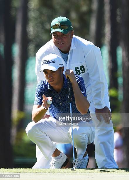 US golfer Justin Thomas lines up a putt on the 3rd hole during Round 1 of the 80th Masters Golf Tournament at the Augusta National Golf Club on April...