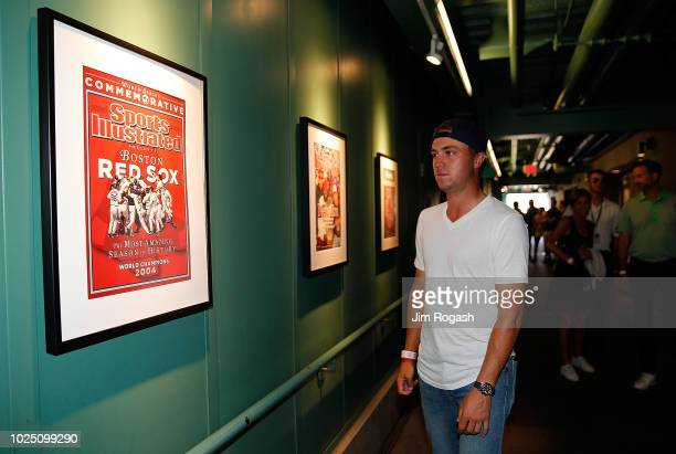 Golfer Justin Thomas looks a photo covers of magazines during a tour of Fenway Park before a game between the Boston Red Sox and the Miami Marlins on...