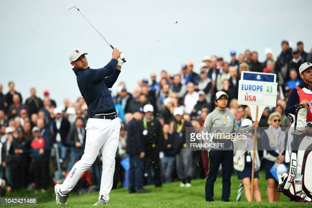 US golfer Justin Thomas plays a fairway shot during his fourball match on the first day of the 42nd Ryder Cup at Le Golf National Course at...