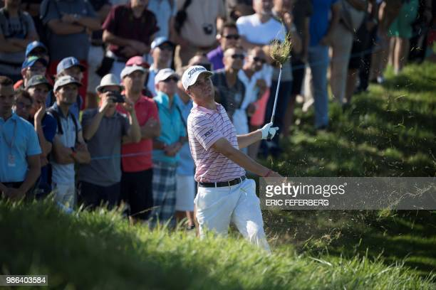 US golfer Justin Thomas plays a shot from the rough as he competes in the HNA Open de France as part of the European Tour 2018 at the...