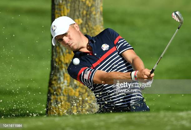 US golfer Justin Thomas plays a shot out of a bunker during a practice session ahead of the 42nd Ryder Cup at Le Golf National Course at...