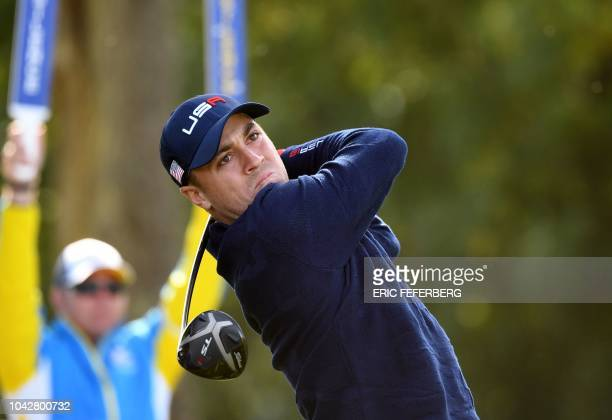 US golfer Justin Thomas plays a tee shot during his fourball match on the second day of the 42nd Ryder Cup at Le Golf National Course at...