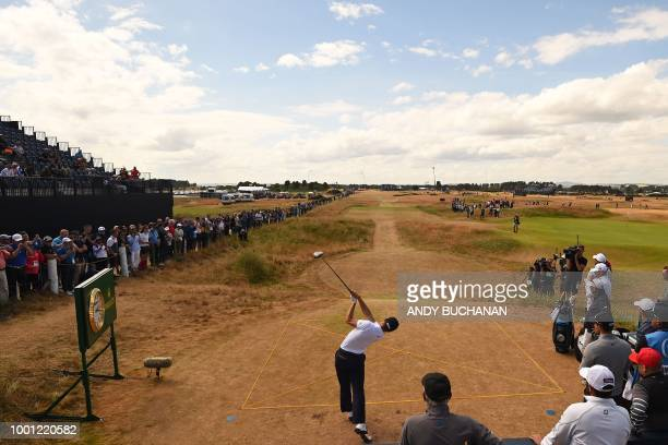 US golfer Justin Thomas plays from the 6th tee during a practice round at The 147th Open golf Championship at Carnoustie Scotland on July 18 2018 /...