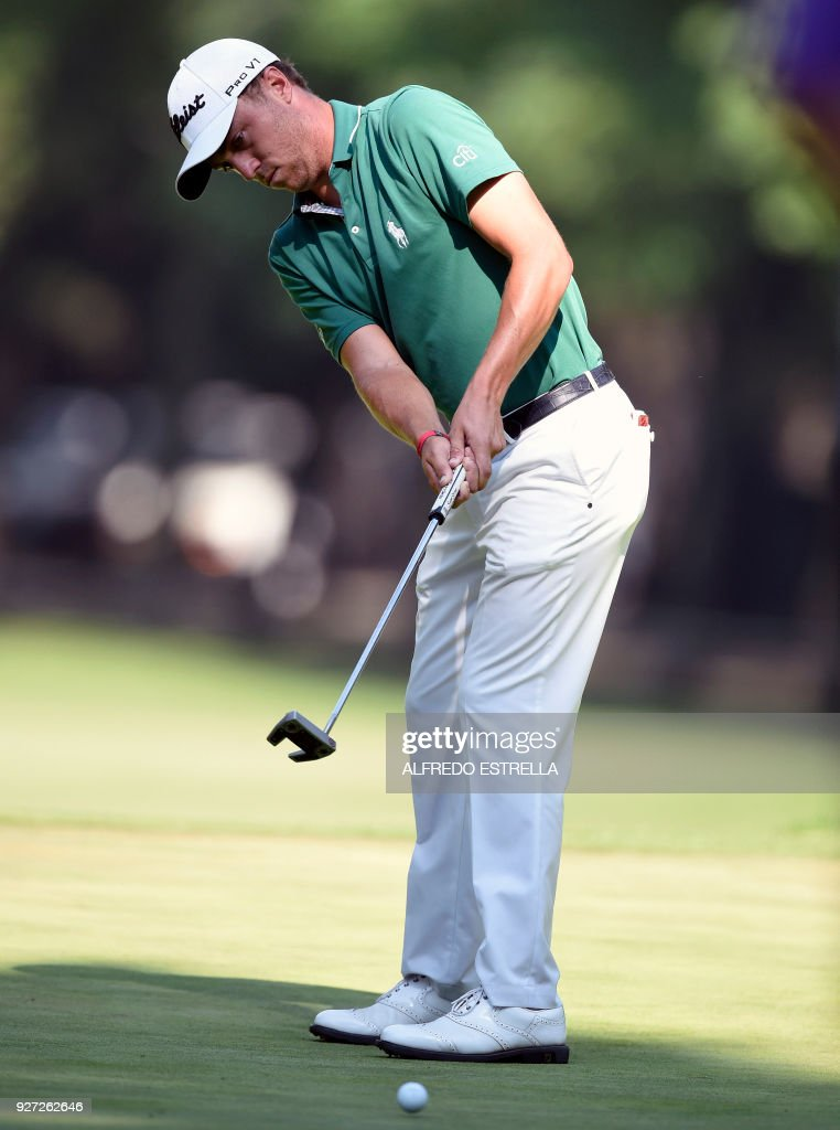 US golfer Justin Thomas plays his shot at green 16, during the fourth and last round of the World Golf Championship in Mexico City, on March 4, 2018. Five-time major winner Phil Mickelson seized his first title in nearly five years on Sunday as he edged Justin Thomas in a playoff to win the WGC Mexico Championship. /