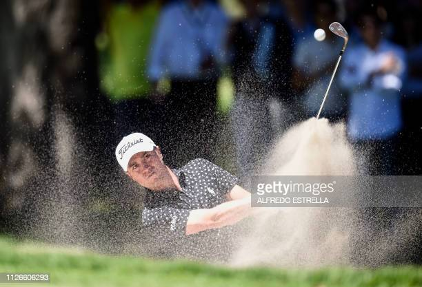 TOPSHOT US golfer Justin Thomas plays his shot from the 10th green during the first round of the World Golf Championship in Mexico City on February...