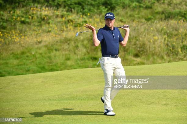 Golfer Justin Thomas plays the 12th hole during a practice session at The 148th Open golf Championship at Royal Portrush golf club in Northern...