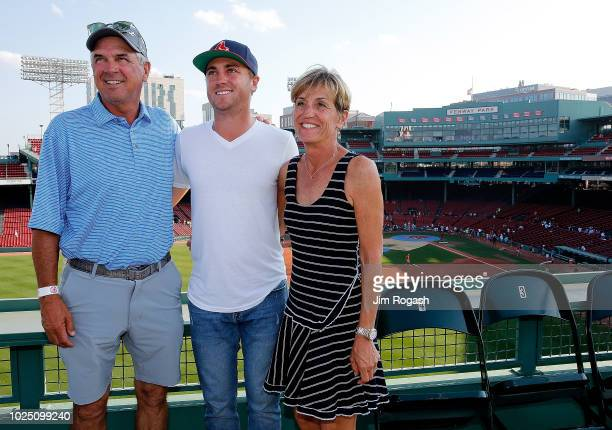 Golfer Justin Thomas poses for a photo with his parents Mike and Jani Thomas during a tour of Fenway Park before a game between the Boston Red Sox...