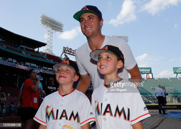 Golfer Justin Thomas poses for a photo with Marlin fans during a tour of Fenway Park before a game between the Boston Red Sox and the Miami Marlins...