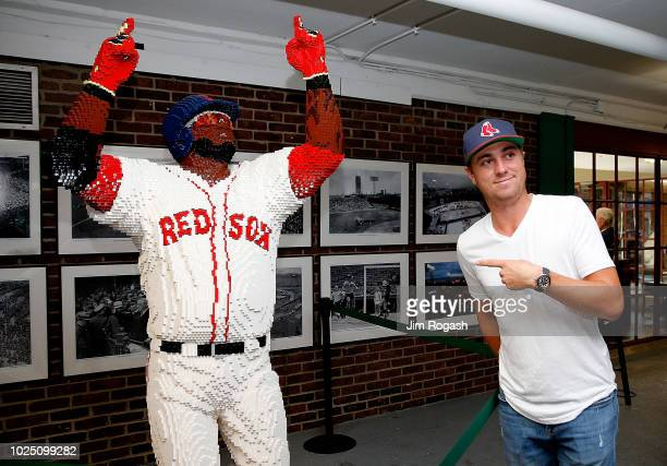 Golfer Justin Thomas poses with a statue of David Ortiz made of Legos building blocks during a tour of Fenway Park before a game between the Boston...