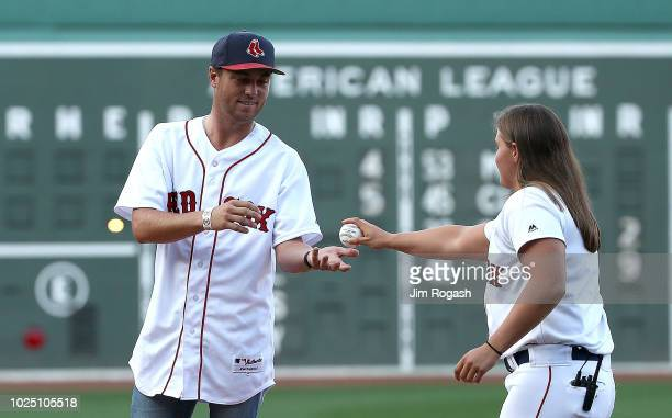 Golfer Justin Thomas prepares to throw out the first pitch at Fenway Park before a game between the Boston Red Sox and the Miami Marlins on August...