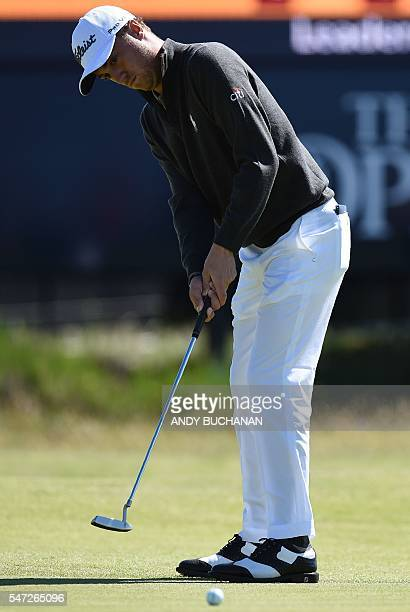 US golfer Justin Thomas putts on the 14th Green during his first round 67 on the opening day of the 2016 British Open Golf Championship at Royal...